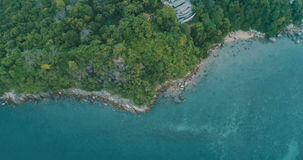 Aerial view of the tropical island and sea. Top view drone flyover tropical island and sea - video in slow motion stock video footage