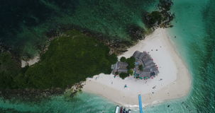 Aerial view of the tropical island and sea. Aerial top view of tropical island Koh Khai Nai and sea with moored yachts stock video footage