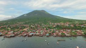 Aerial view of tropical island Ternate with Gamalama volcano, Indonesia. Aerial view of tropical island Ternate with Gamalama volcano in the middle, Indonesia stock video footage