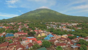Aerial view of tropical island Ternate with Gamalama volcano, Indonesia. Aerial view of tropical island Ternate with Gamalama volcano in the middle, Indonesia stock video