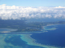 Aerial View Tropical Islands. Fiji, aerial,view,plane,islands,reef,clouds,blue,sky,water Royalty Free Stock Image