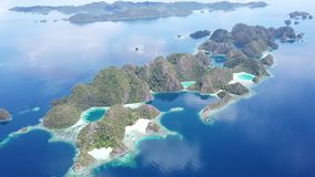 Aerial View of Tropical Islands in Raja Ampat. The stunning limestone islands of Raja Ampat, Indonesia, are surrounded by healthy coral reefs. This remote region stock video