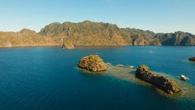 Aerial view tropical lagoon,sea, beach. Tropical island. Busuanga, Palawan, Philippines. Aerial view: beach, tropical island, sea bay and lagoon, mountains with stock video