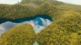 Aerial view tropical lagoon,sea, beach. Tropical island. Siargao, Philippines. Aerial view: beach, tropical island, sea bay and lagoon, Siargao. Tropical stock footage
