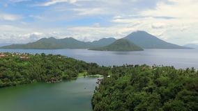 Aerial view of tropical Lake Tidore and volcano island in Ternate, Indonesia. stock video
