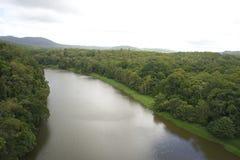 Aerial view of tropical rainforest with river. Aerial view of tropical rainforest and the Barron River near Kuranda, Cairns, Queensland Australia. The rainforest stock photos