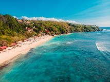 Aerial view of tropical sandy beach with crystal blue ocean in Bali. Drone shot stock photography