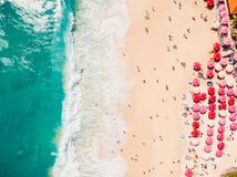 Aerial view of tropical sandy beach with turquoise ocean in resort stock photography