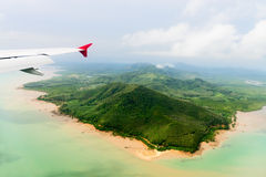 Aerial view of the tropical shore under airplane Stock Photography