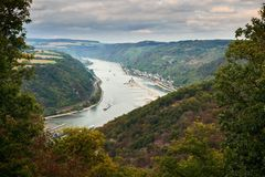 Aerial view trough trees on the river Raine from an observation point on a tourist route on hills of Hessen state in. Aerial view to hills of Rheinland-Pfalz stock images