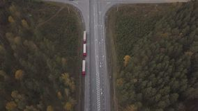Aerial view truck car with freight container parking on roadsideat highway. On background autumn forest. Three freight truck on suburban road stock footage