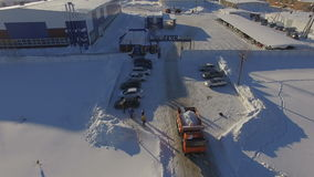Aerial view truck drives out from gas company territory stock footage