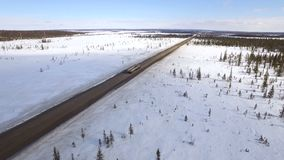 Aerial view of truck moving on winter road stock video footage