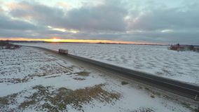 Aerial view of truck moving on winter road. Amazing sunset. Nature landscape. stock footage