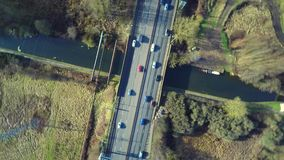 Aerial view of a truck and other traffic driving along a road. At sunrise stock video