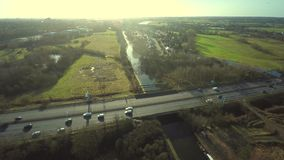 Aerial view of a truck and other traffic driving along a road stock video footage