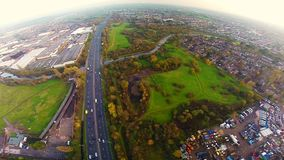 Aerial view of a truck and other traffic driving along a road. At sunrise stock video footage
