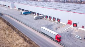 Aerial view of trucks parked in front of industry building. Aerial royalty free stock photography
