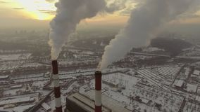 Aerial view of a tube with smoke at winter sunset.  stock video footage
