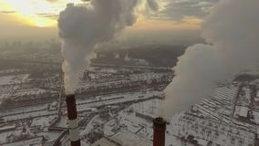 Aerial view of a tube with smoke at winter sunset.  stock video