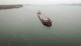 Aerial view of tug boat pushing empty barge stock video