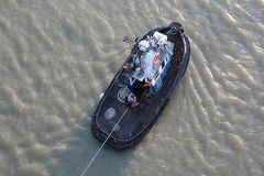 High Angle View of tugboat and tow line. Stock Photography