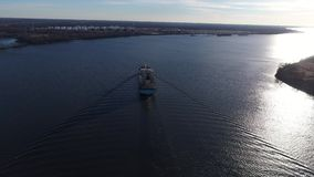 Aerial View of Tugboat Assisting Cargo Ship Delaware River. Philadelphia PA stock footage