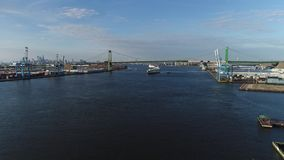 Aerial View of Tugboat Assisting Cargo Ship Delaware River. Philadelphia PA stock video footage