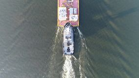 Aerial view of tugboat and barge Delaware River in Philadelphia stock footage