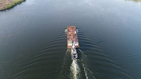 Aerial view of tugboat and barge Delaware River in Philadelphia. Aerial View of Tugboat and Barge Delaware River Philadelphia stock footage