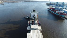 Aerial View of Tugboat and Cargo Ship Delaware River Philadelphia.  stock footage