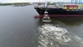 Aerial View of Tugboat and Cargo Ship Delaware River Philadelphia stock video footage