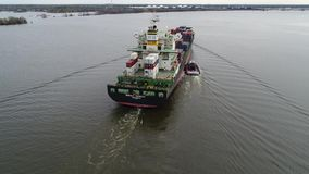 Aerial View of Tugboat and Cargo Ship Delaware River Philadelphia.  stock video footage