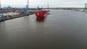 Aerial View Tugboat Parking a Container Ship in Philadelphia. Port stock video