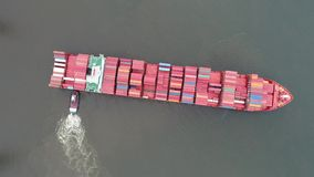 Aerial View Tugboat Parking a Container Ship in Philadelphia. Port stock footage
