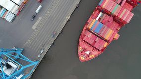 Aerial View Tugboat Parking a Container Ship in Philadelphia. Port stock video footage