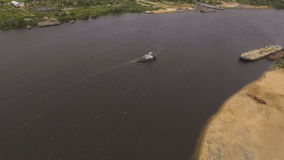 Aerial view:Tugboat on the river. Aerial view:tug sailing on a big river.Aerial:flying over the river tugboat.4K video,ultra HD stock video