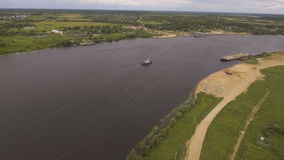 Aerial view:Tugboat on the river. Aerial view:tug sailing on a big river.Aerial:flying over the river tugboat.4K video,ultra HD stock footage
