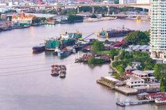 Aerial view of tugboat shipping barges, Bangkok city at Chao Pha Royalty Free Stock Image