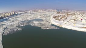 Aerial view of Tulcea city harbor and the Danube covered in ice floes.  stock video
