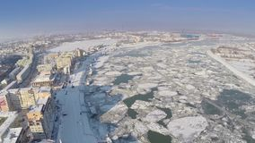Aerial view of Tulcea city harbor and the Danube covered in ice floes.  stock footage