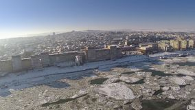 Aerial view of Tulcea city harbor and the Danube covered in ice floes stock video footage