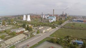 Aerial view of Tulcea city, industrial area and bauxite alumina refinery.  stock footage