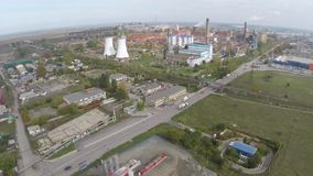 Aerial view of Tulcea city, industrial area and bauxite alumina refinery.  stock video footage
