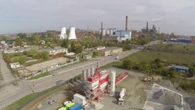 Aerial view of Tulcea city, industrial area and bauxite alumina refinery stock video footage