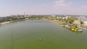 Aerial view of Tulcea city and lake Ciuperca.  stock footage