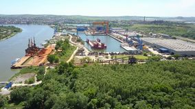 Aerial view of Tulcea city. Shipyard and the danube before flowing into the sea stock video footage
