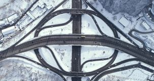 Aerial view of a turbine road interchange in Kiev. Aerial Drone Flight View of freeway busy city rush hour heavy traffic jam highway. Top view. Cityscape in stock video