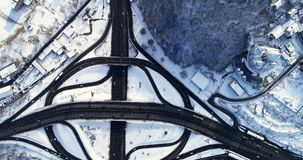 Aerial view of a turbine road interchange in Kiev. Aerial Drone Flight View of freeway busy city rush hour heavy traffic jam highway. Top view. Cityscape in stock footage
