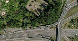 Aerial view of a city traffic on the bridge. Aerial view of a turbine road interchange in Kiev. Aerial Drone Flight View of freeway busy city rush hour heavy stock video
